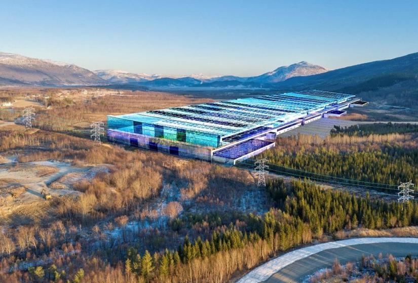 FABRIKKEN. Slik kan batteri-fabrikken komme til å ta seg ut i terrenget nord for Fauske. Visuell framstilling: Drone Nord Foto: Per Inge, Bodø kommune
